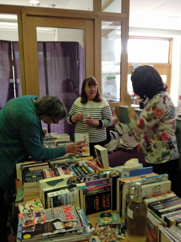 WI members hard at work on the book stall.